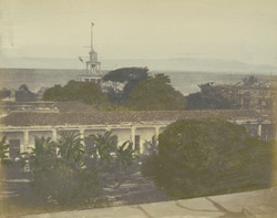 Harbour of Colombo [with the lighthouse visible over the rooftops].